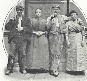A group of people drinking.
