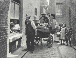 A family with thier possessions on a cart move house.