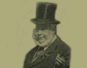 A photograph showing the Earl of Sheffield wearing a top hat.