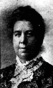A photograph of a lady in Victorian attire.