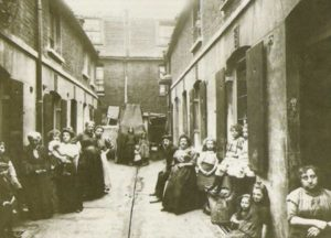 People gathered in one of the East End Alley.