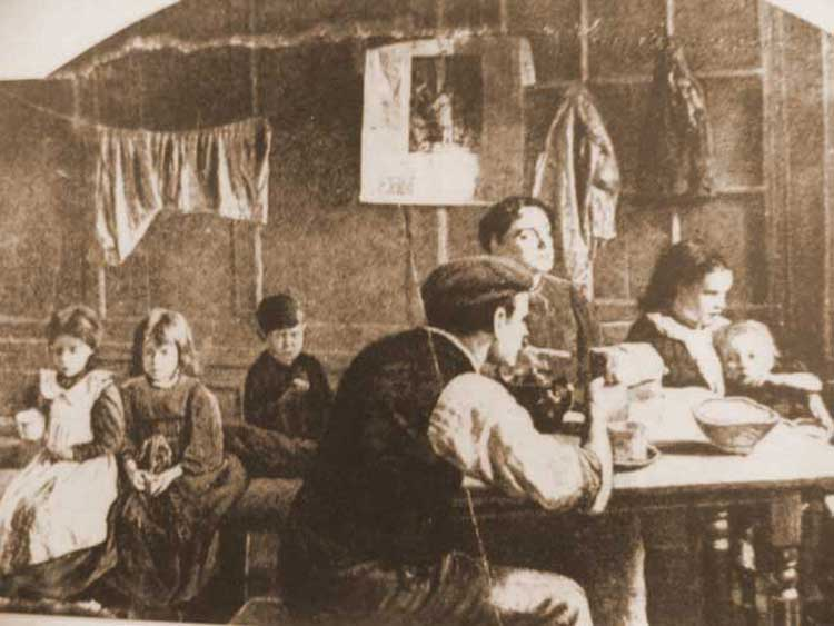A photograph of a family in their room.