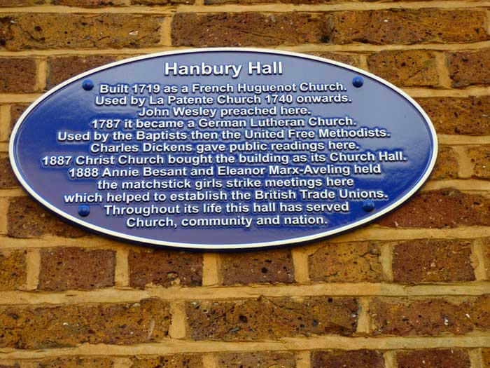 A photograph of the blue plaque that gives the history of Hanbury Hall.
