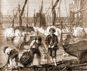 A group of mudlarks scavenge by the shipping on the Thames.