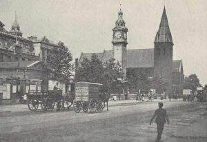 A photograph showing another section of Mile End Road.