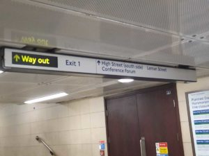 The sign for exit one inside the station.