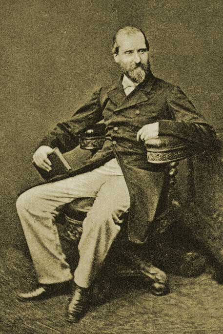 A photograph of Henry Vizetelly showing him seated in a chair.