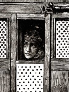 A woman in a cell awaiting her court appearance.