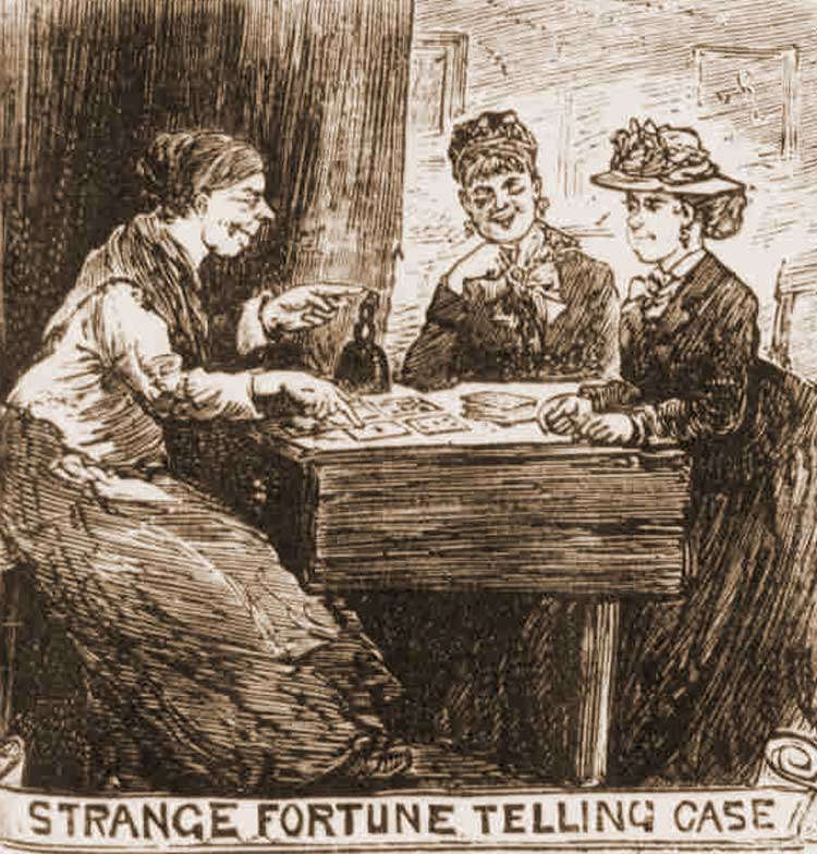 Sarah Ellmore telling the fortunes of two girls.