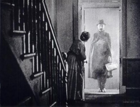 A man at the door, a still from The Lodger.