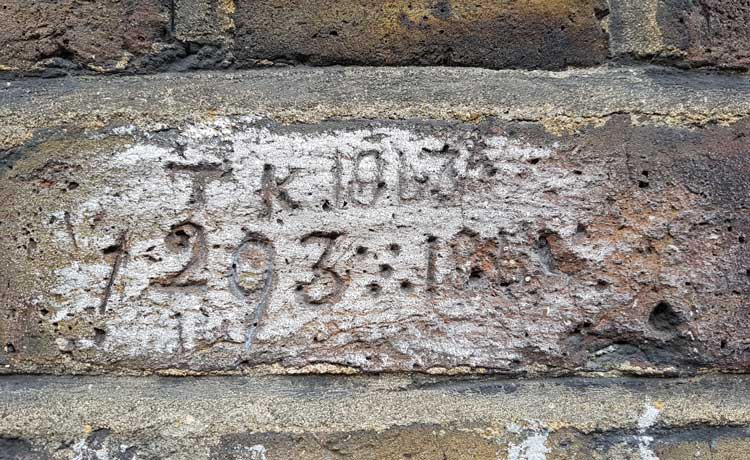 TK 293 carved into one of the bricks.
