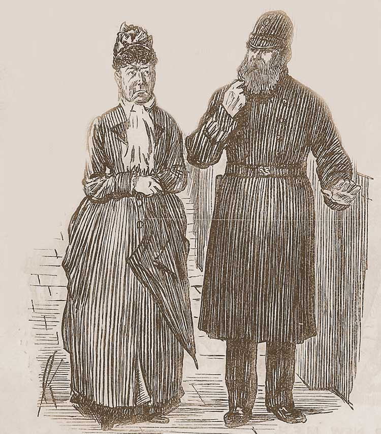 A policeman talking with a woman.