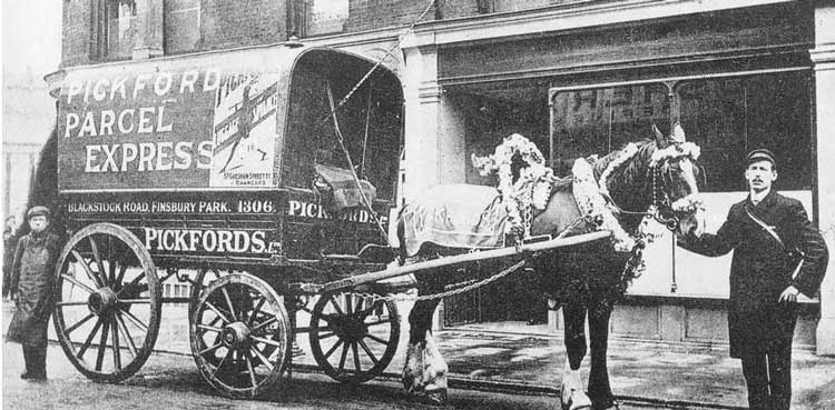 A horse-drawn Pickfords Van.